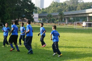 Enthusiastic players doing warming up exercises
