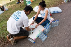 Volunteers building chairs  using plastic bottles